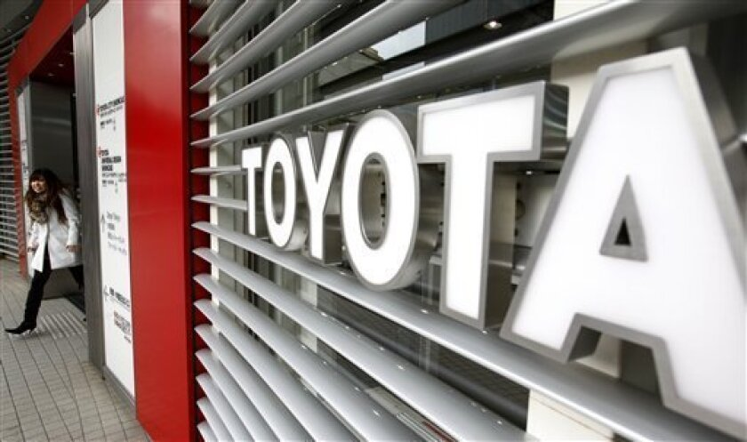 In this Jan. 28, 2010 photo, a visitor leaves a Toyota Motor Corp. showroom in Tokyo, Japan. Toyota is the latest in a string of corporate Japanese icons to make headlines for all the wrong reasons. (AP Photo/Shizuo Kambayashi)