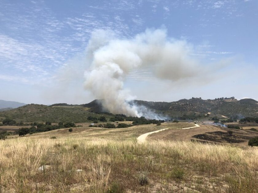 Officials said the blaze on De Luz Road near Weisgarber Gate Road on Camp Pendleton was reported shortly before 2 p.m.