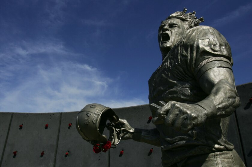 A statue of Pat Tillman stands outside State Farm Stadium in Glendale, Ariz.
