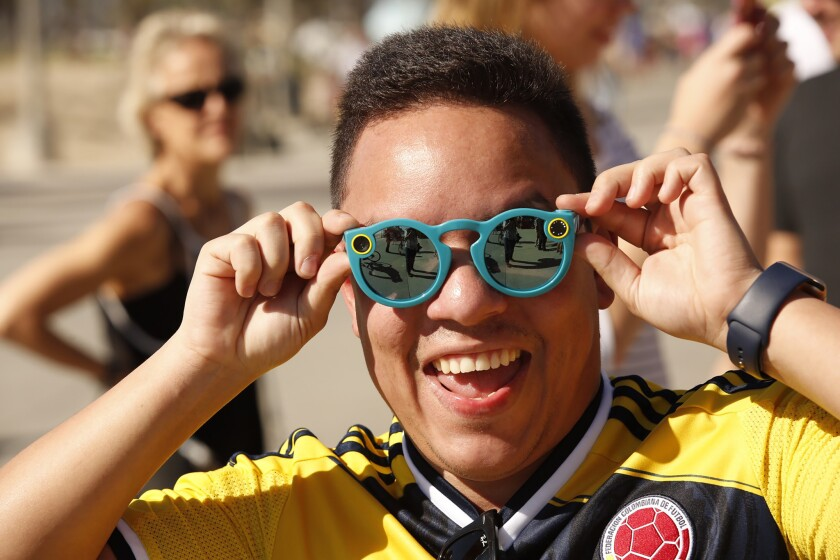 Los Angeles resident Albert Borrero, 32, tries his Spectacles in Venice. Filings suggest Snap Inc. may also plan to sell the video-camera sunglasses from vending machines in Texas and Oregon.