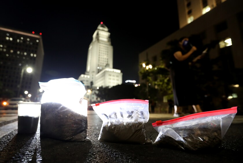Exide protesters leave bags of lead-contaminated dirt in downtown L.A.