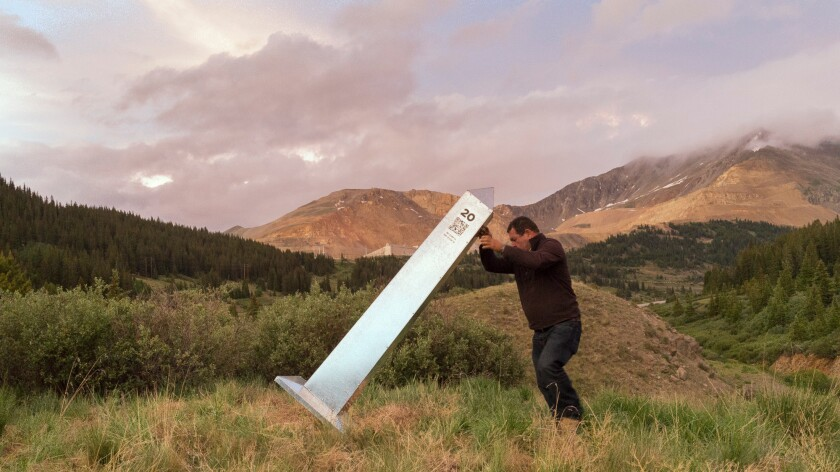 """Marcos Ramirez, known as """"ERRE,"""" erects a monument to mark the 1821 U.S.-Mexico border north of Leadville, Colo. — a project now on view at MCASD."""