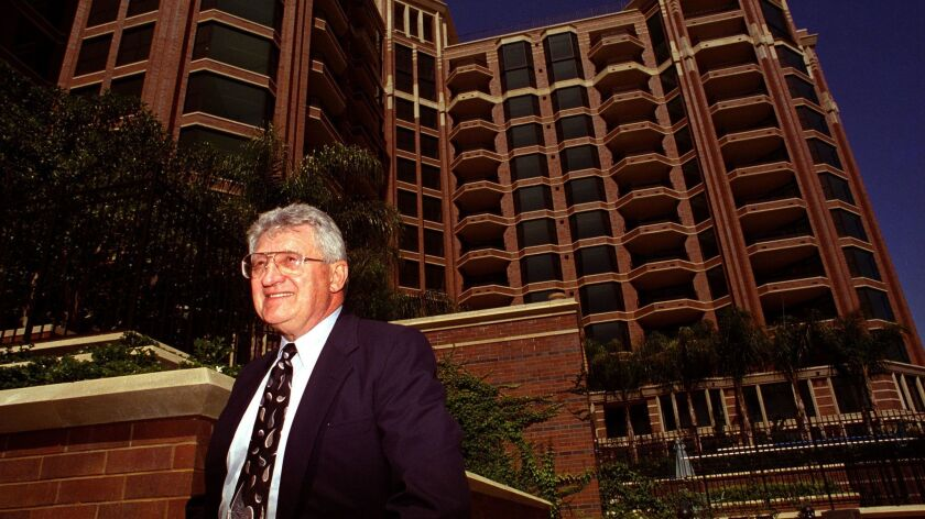 Max Schmidt outside the CityFront Terrace condominium project on Harbor Drive between Market and Union streets in this 1994 file photo.