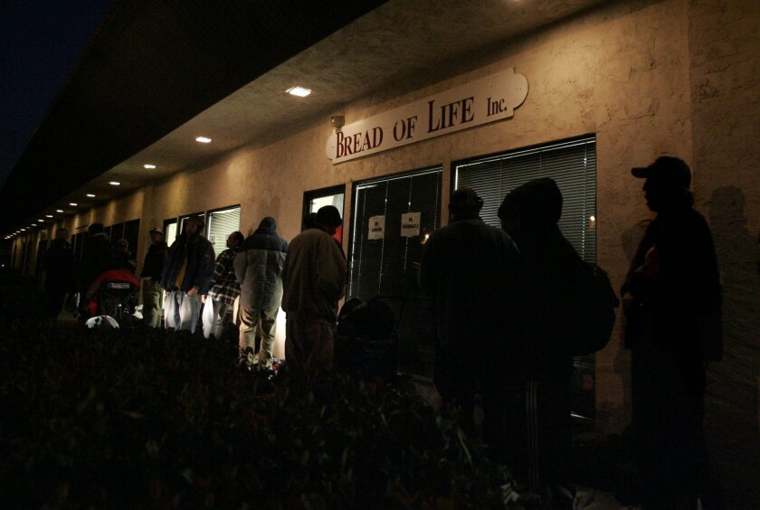 In this photo from 2006, homeless people line up outside Bread of Life in Oceanside. The shelter closed a year ago.