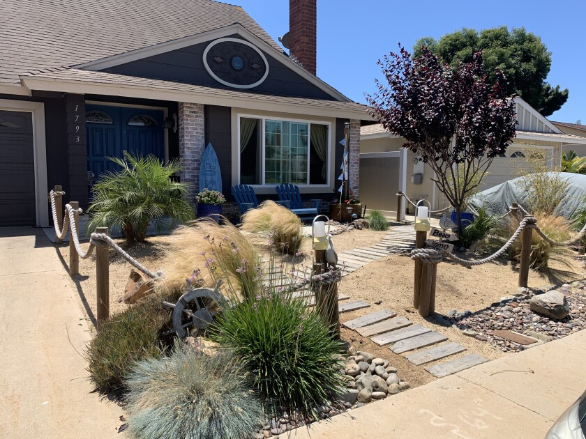 Tracy Stephenson's South Bay front yard has a whimsical beach vibe, with a boardwalk fashioned from old pallets.