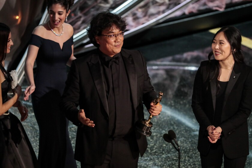"""Bong Joon Ho accepts the international feature Oscar for """"Parasite"""" during the telecast of the 92nd Academy Awards."""