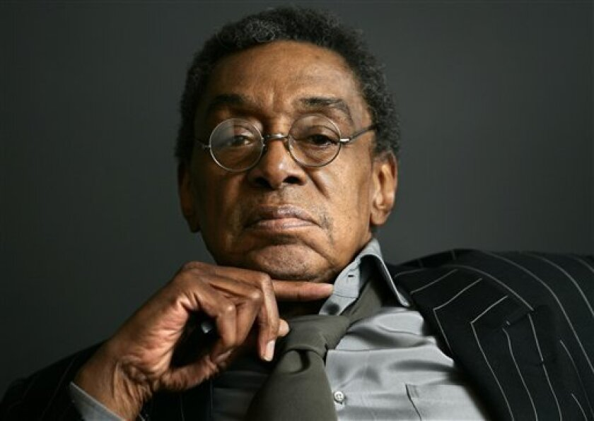 """This March 6, 2006, file photo shows former host of the television show """"Soul Train,"""" Don Cornelius at his office in Los Angeles. Cornelius has pleaded not guilty Thursday, Dec. 4, 2008 to charges of spousal battery. (AP Photo/Damian Dovarganes, file)"""