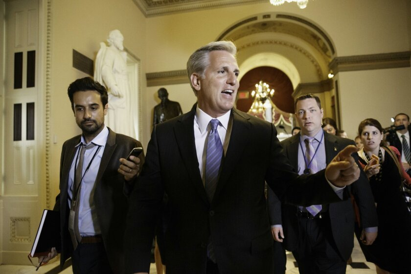 In this June 11, 2014, photo, House Majority Whip Kevin McCarthy of Calif., leaves House Speaker John Boehner's office on Capitol Hill in Washington. McCarthy's knack for helping colleagues get elected and his ability to maintain a personal connection have given him the advantage in the race for House majority leader, despite calls by some Republicans for a new, more conservative direction. (AP Photo/J. Scott Applewhite)