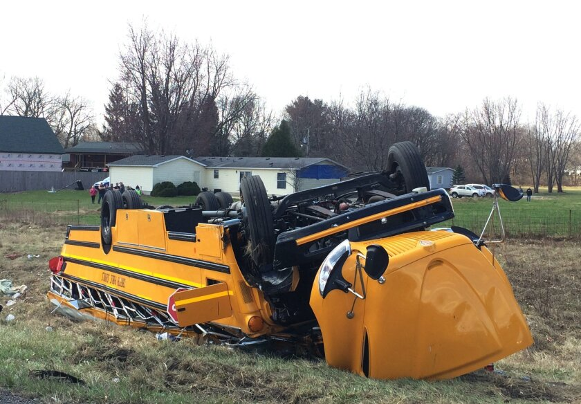 A school bus carrying Griffith High boys basketball team is seen overturned in Demotte, Ind., Saturday, March 19, 2016. The bus rolled over on Interstate 65 on the way to Saturday's semifinal game against Marion at Lafayette Jefferson. (Jonathan Miano/The Times via AP) MANDATORY CREDIT