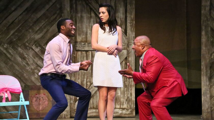 """Hiro's sister (Jacqueline Misaye) with her fiance (Christian Telesmar), left,  and their pastor (Mel Hampton) in """"Kentucky."""""""