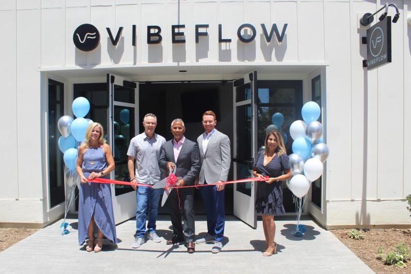 Lori Cavallo, Brian Ahern, Billy Borja, Chris Wilke and Lisa Borja at the ribbon cutting with the San Diego Coastal Chamber of Commerce on July 26.