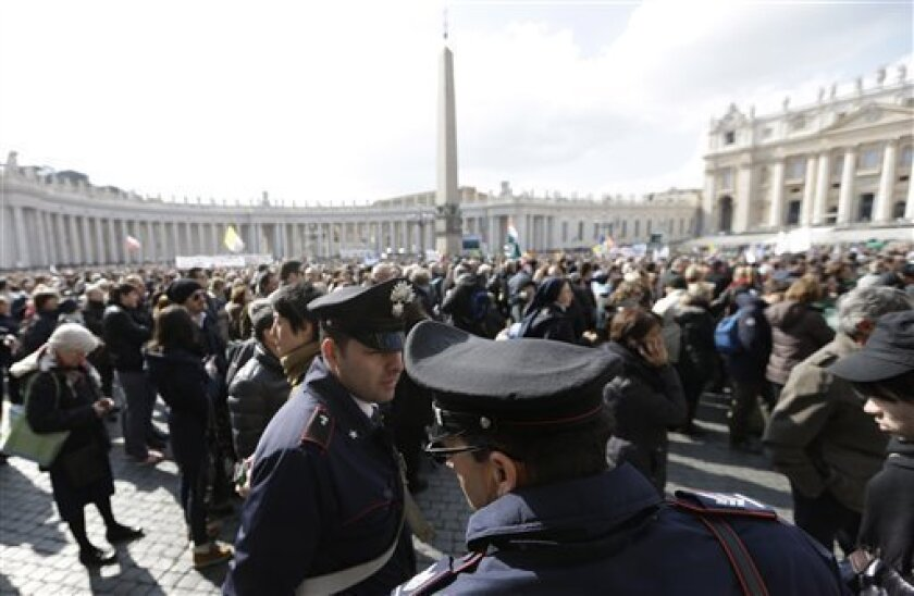 FILE -- In this file photo taken on Feb. 24, 2013, policeman patrol as faithful gather the last Angelus noon prayer of Pope Benedict XVI, celebrated from the window of his studio overlooking St. Peter's square at the Vatican. Planning for the moment when the next pope is proclaimed to the world, and for the installation ceremony a few days later, is a big-time guessing game. And that adds up to an ungodly logistical headache for the city of Rome. Nearly everything went smoothly for Benedict's