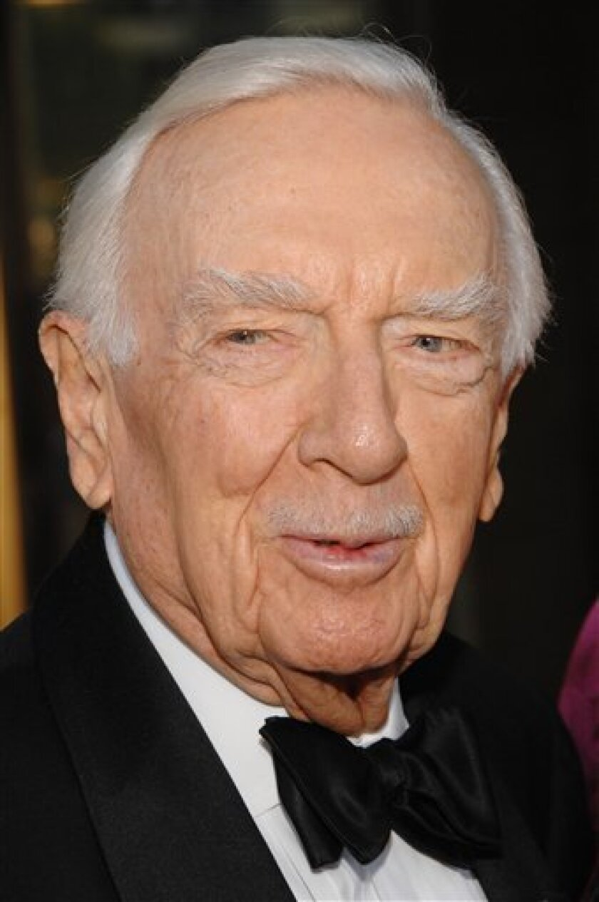 FILE - In this photo taken on Sept. 24, 2007, former news anchor Walter Cronkite arrives at the Metropolitan Opera 2007-08 season opening gala. (AP Photo/Evan Agostini, File)