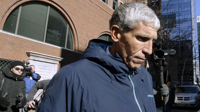 """William """"Rick"""" Singer departs federal court in Boston in March after he pleaded guilty to charges in a nationwide college admissions bribery scandal."""
