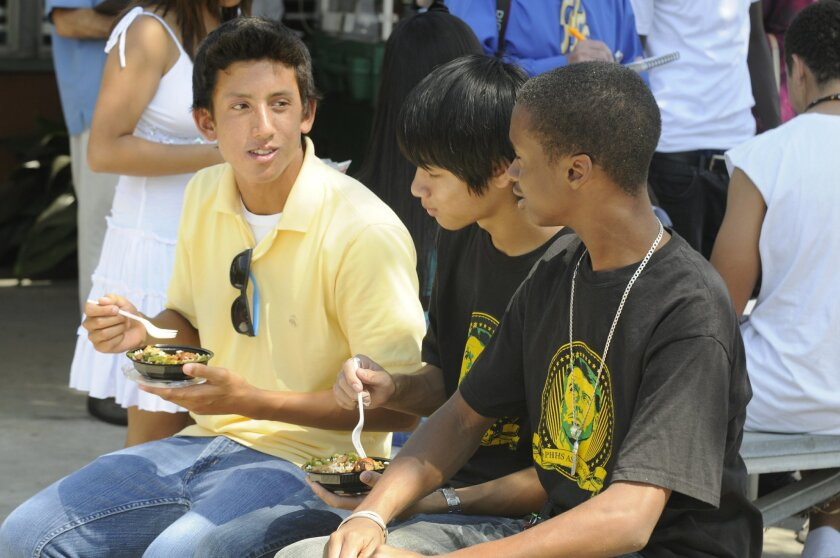 Patrick Henry High School students (from left) Aaron Barranco, Jordan Trinh and Devereaux Watson, all 16, took part in yesterday's lunch preview at Mission Bay High. (David Brooks)