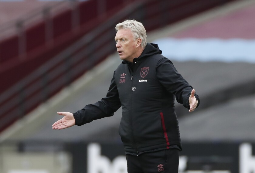 West Ham's manager David Moyes gives instructions during the English Premier League soccer match between West Ham United and Arsenal at the London Stadium in London, England, Sunday, March 21, 2021. (Paul Childs, Pool via AP)
