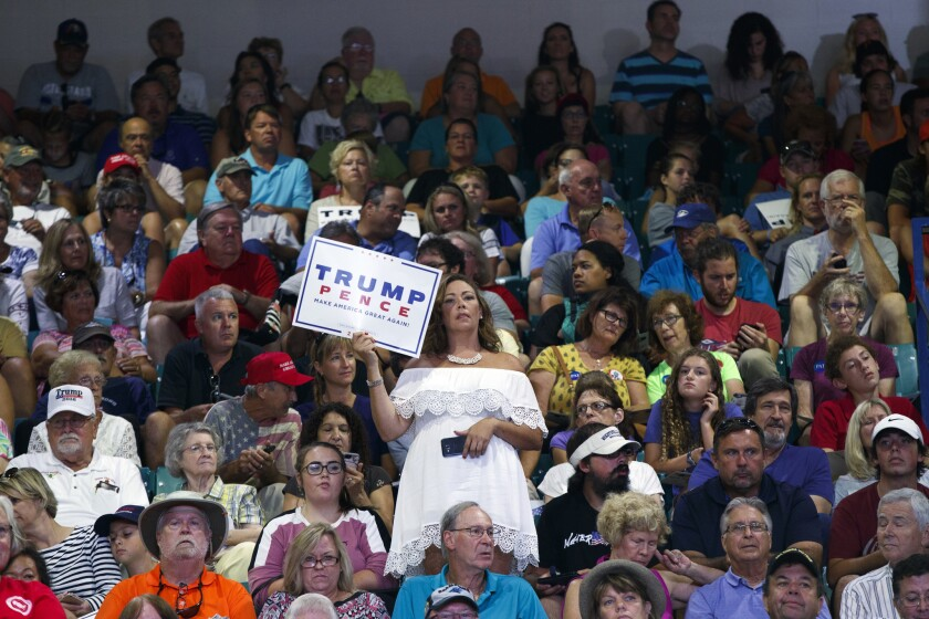 Donald Trump supporters wait for his arrival at a rally at the University of North Carolina in Wilmington, N.C.