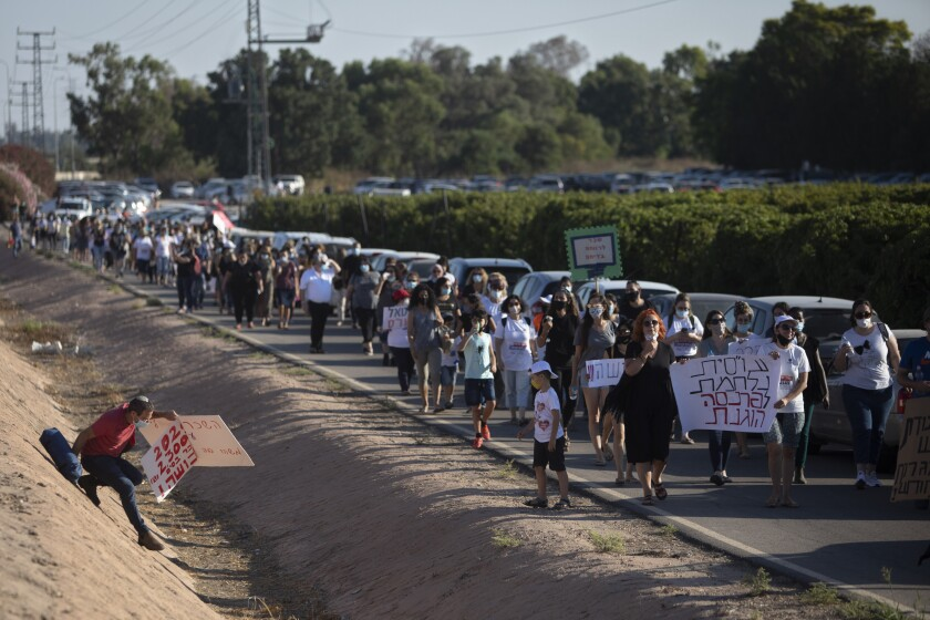 Israeli social workers protest the country's economic situation July 10.