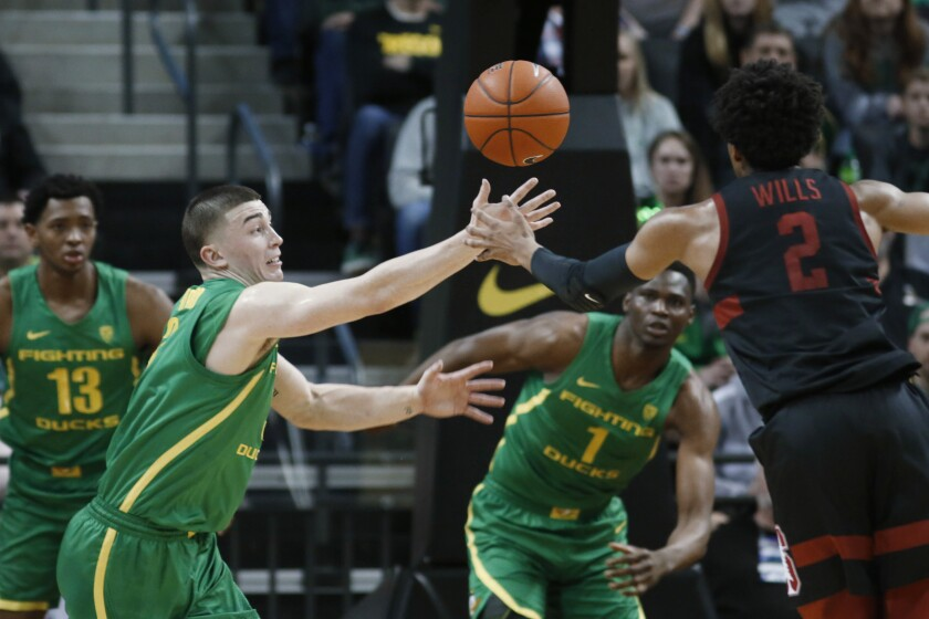 Oregon's Payton Pritchard, left, goes for the steal against Stanford's Bryce Wills on March 7, 2020, in Eugene, Ore.