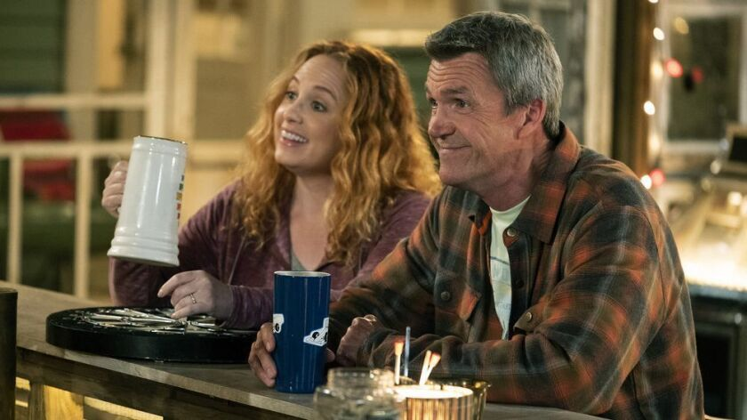 """Jessica Chaffin as Beth and Neil Flynn as Fred, regulars at the eponymous bar in the new NBC sitcom """"Abby's."""""""