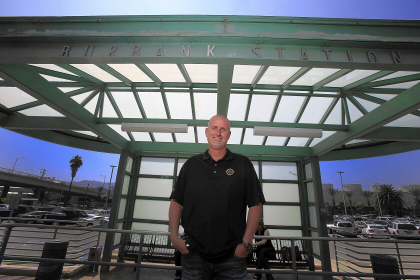 Sean Robb of Valencia stands on his former train platform at the Metrolink station in Burbank. Robb now drives himself to work instead of taking the train, which was often late, causing him to miss his bus connection to his job at Walt Disney Imagineering.