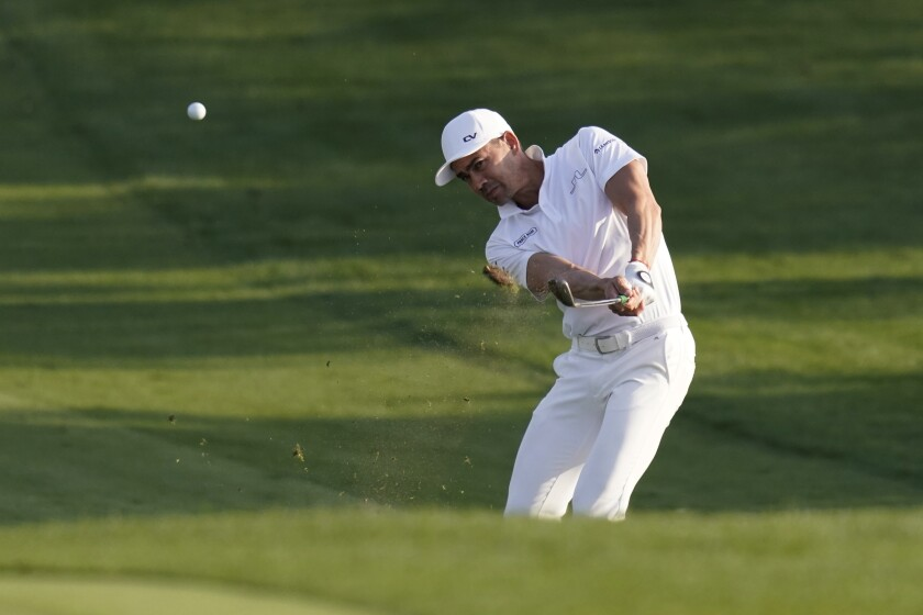 Camilo Villegas, of Colombia, hits from the fairway on the eighth hole during the first round of the Texas Open golf tournament, Thursday, April 1, 2021, in San Antonio. (AP Photo/Eric Gay)