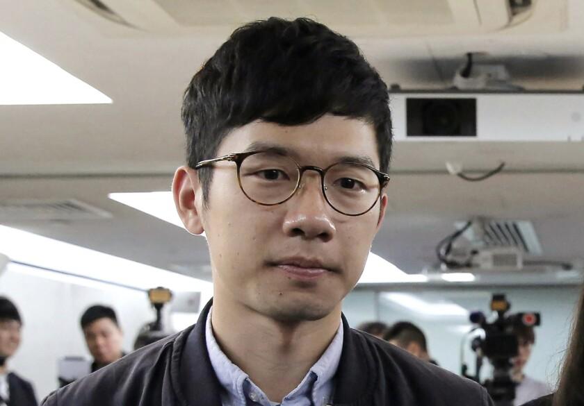 En esta imagen de archivo, tomada el 27 de enero de 2018, el activista prodemocracia Nathan Law, durante una conferencia de prensa en Hong Kong. (AP Foto/Kin Cheung, archivo)