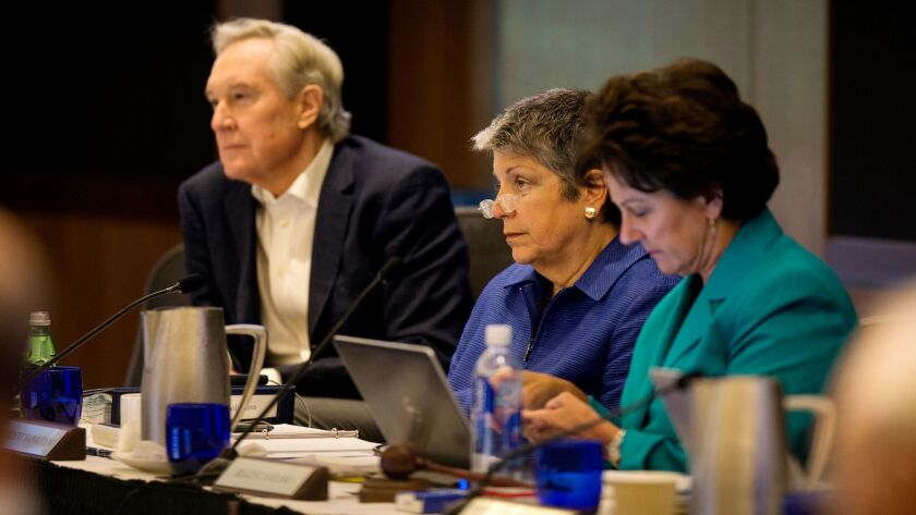 Regent George Kieffer, left, UC President Janet Napolitano and Regent Chairwoman Monica Lozano listen to a presentation at UCLA. UC regents discussed rising college costs this week in San Francisco.