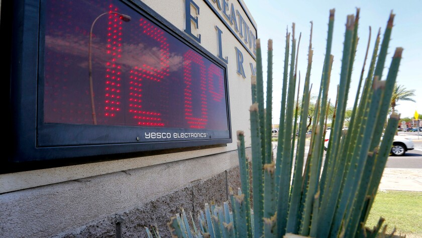 Sign indicates the temperature in Phoenix on a June day.