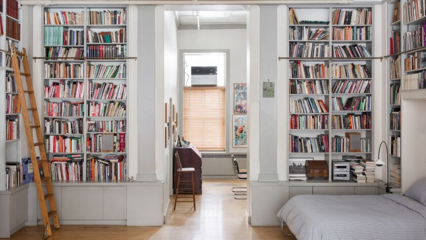 "In a downtown Manhattan apartment with more books than square feet, a Murphy bed is tucked among built-in bookshelves. Reprinted with permission from ""Bibliostyle: How We Live at Home With Books"" by Nina Freudenberger."