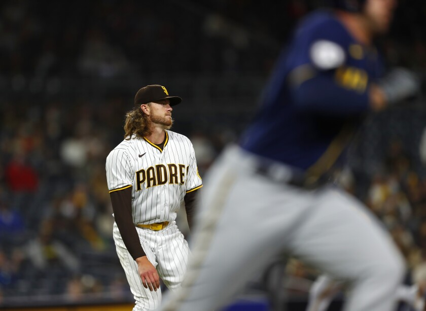 The Padres' Chris Paddack watches a two-RBI double by Milwaukee Brewers' Travis Shaw in the third inning Tuesday.