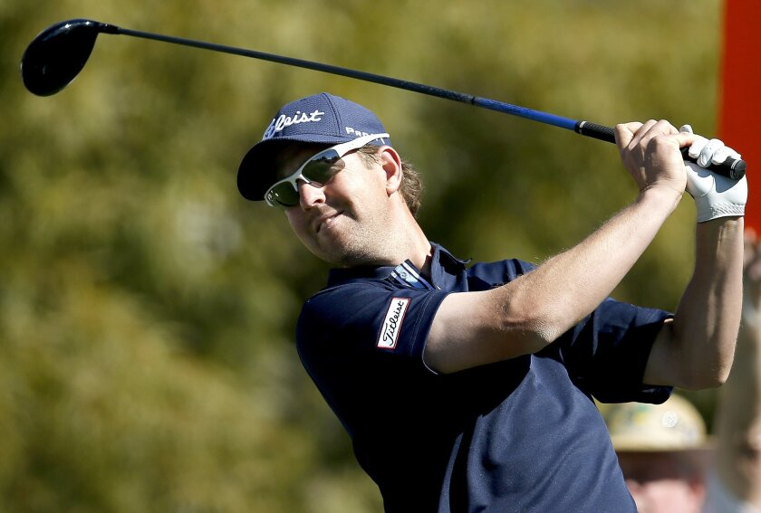 Bryce Molder tees off on the fifth hole during the final round of the Phoenix Open golf tournament, Sunday, Feb. 7, 2016, in Scottsdale, Ariz. (AP Photo/Rick Scuteri)