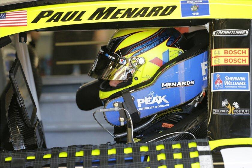 Paul Menard prepares to practice for the NASCAR Daytona 500 auto race at Daytona International Speedway, Wednesday, Feb. 17, 2016, in Daytona Beach, Fla. (AP Photo/Terry Renna)