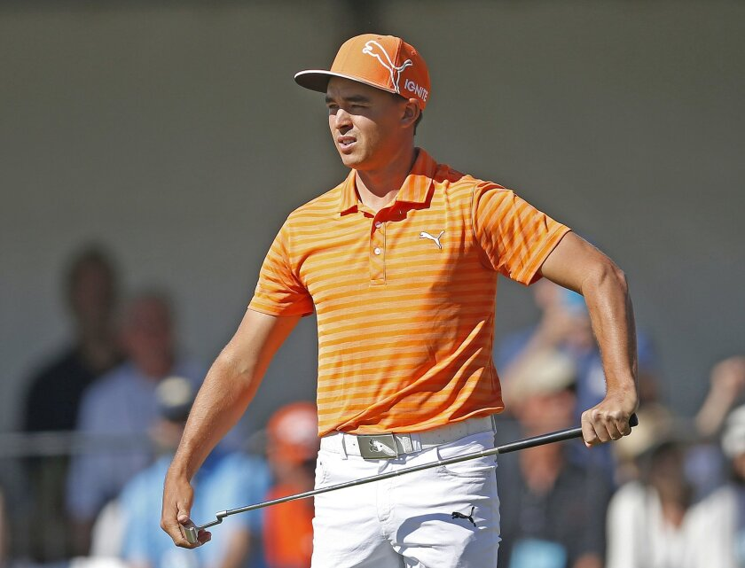 Rickie Fowler reacts after missing a birdie putt on the fourth hole during the final round of the Phoenix Open golf tournament, Sunday, Feb. 7, 2016, in Scottsdale, Ariz. (AP Photo/Rick Scuteri)