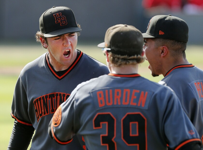 "Huntington Beach's Joshua Hahn yells ""Lets Go"" to his teammates after getting out of a jam in the fo"