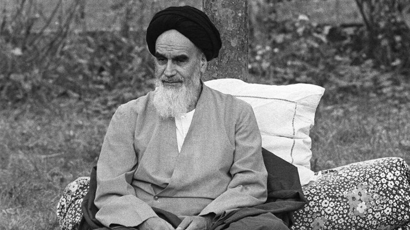 Ayatollah Khomeini sits in his garden Oct. 10, 1978, in Neauphle-Le Chateau, near Paris, a few months before his return to Iran during the Islamic Revolution.