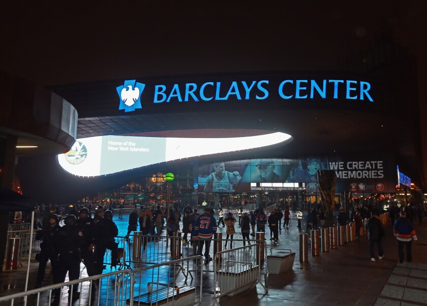 Patrons arrive at the Barclays Center for a Dec. 2 game between the New York Islanders and the New York Rangers in Brooklyn, N.Y.