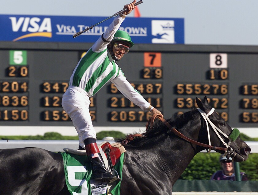 Jockey Victor Espinoza celebrates after riding War Emblem to victory in the 128th Kentucky Derby at Churchill Downs on Saturday, May 4, 2002, in Louisville, Ky.