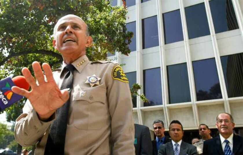 L.A. County Sheriff Lee Baca addresses the media outside the Sheriff's headquarters in Monterey Park, responding to the ACLU of Southern California calling for his resignation on Sept. 28. (Los Angeles Times)