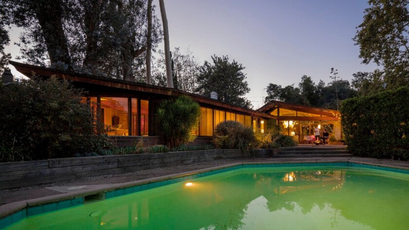 With its sawtooth roof, brick, glass and wood composition, Frank Lloyd Wright Jr.'s Dorland House in Altadena is reminiscent of his father's Usonian-style homes.