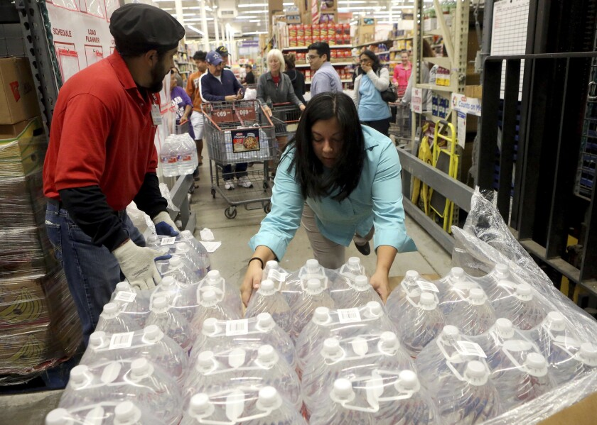 Free bottled water is prepared for distribution after Corpus Christi, Texas, residents were warned not to use tap water that might be tainted with chemicals.
