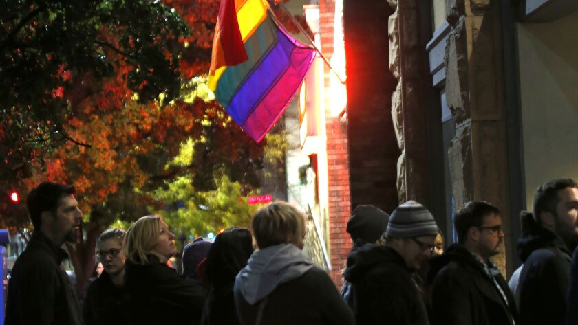 People wait to get into an event supporting gay and lesbian families on Nov. 9 in Salt Lake City.