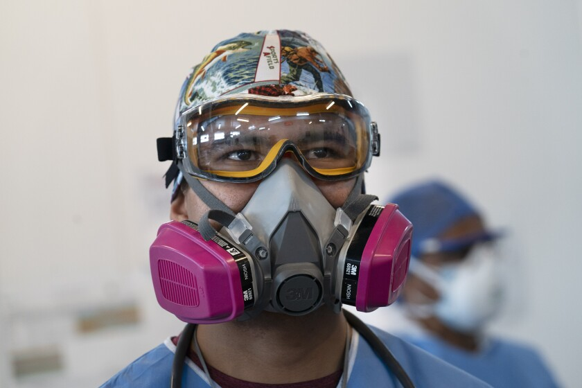 A health worker wears a protective mask and goggles at the Ajusco Medio General Hospital which is designated for COVID-19 cases only, in Mexico City, Tuesday, Aug. 31, 2021. (AP Photo/Marco Ugarte)
