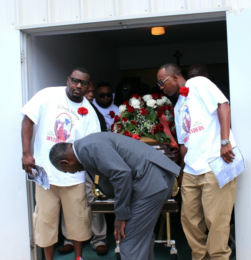 Pallbearers bring out the casket containing the body of Stonewall, Miss., resident Jonathan Sanders following his funeral services Saturday, July 18, 2015, at the Family Life Center in Quitman, Miss. Sanders, who had been driving a horse and buggy died after a fight with a Stonewall police officer. (Jeff Byrd/The Meridan Star via AP) MANDATORY CREDIT