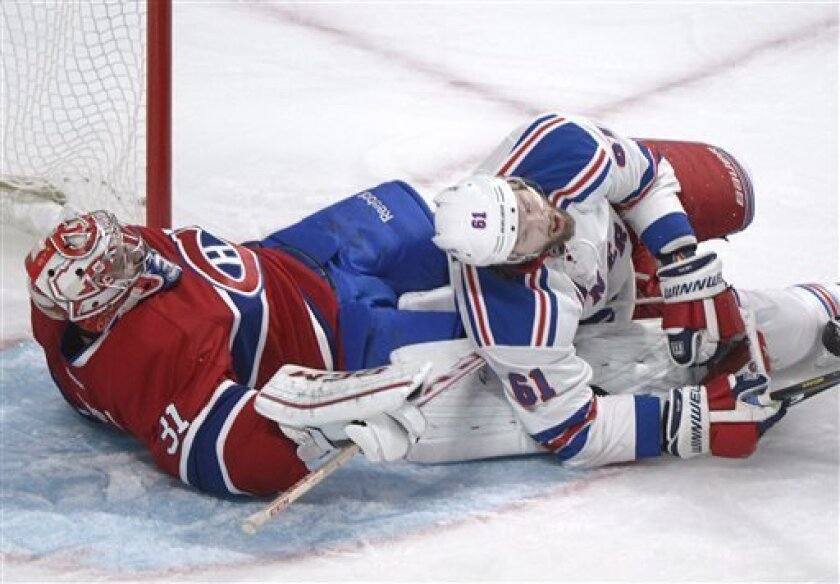 New York Rangers' Rick Nash, right, collides with Montreal Canadiens goaltender Carey Price during second-period NHL hockey game action in Montreal, Saturday, March 30, 2013. (AP Photo/The Canadian Press, Graham Hughes)