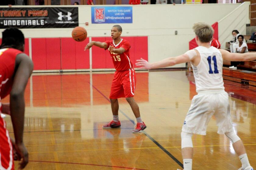 Cathedral player Christian Moore (#15) passes the ball