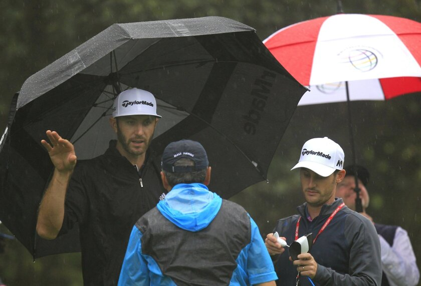 Dustin Johnson of the United States, left, talks to an amateur on the 10th hole during the Pro-Am event of the HSBC Champions golf tournament at the Sheshan International Golf Club in Shanghai, China Wednesday, Nov. 4, 2015. (AP Photo)
