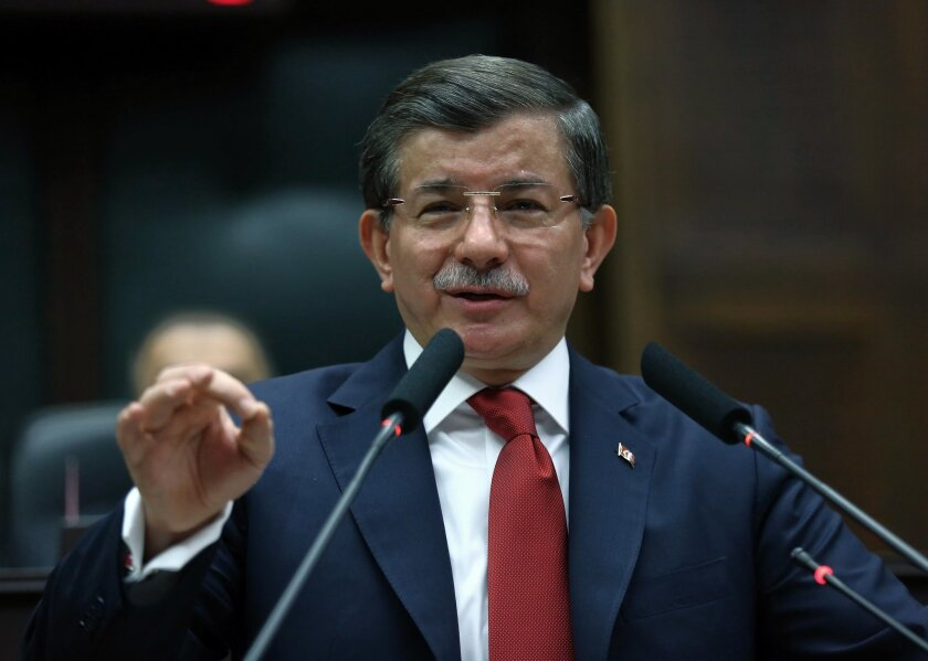 Turkish Prime Minister Ahmet Davutoglu addresses his lawmakers in Ankara, Turkey, Tuesday, Feb. 16, 2016. Turkish artillery continue to pound the positions in northern Syria as a Turkish official says his country is pushing the case for ground operations in Syria, hoping for the involvement of the