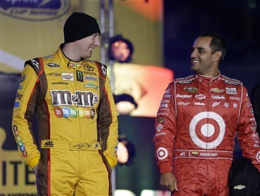 Kyle Busch, left, and Juan Pablo Montoya, of Colombia, laugh during driver introductions for the NASCAR Sprint Unlimited auto race at Daytona International Speedway, Saturday, Feb. 16, 2013, in Daytona Beach, Fla. (AP Photo/John Raoux)