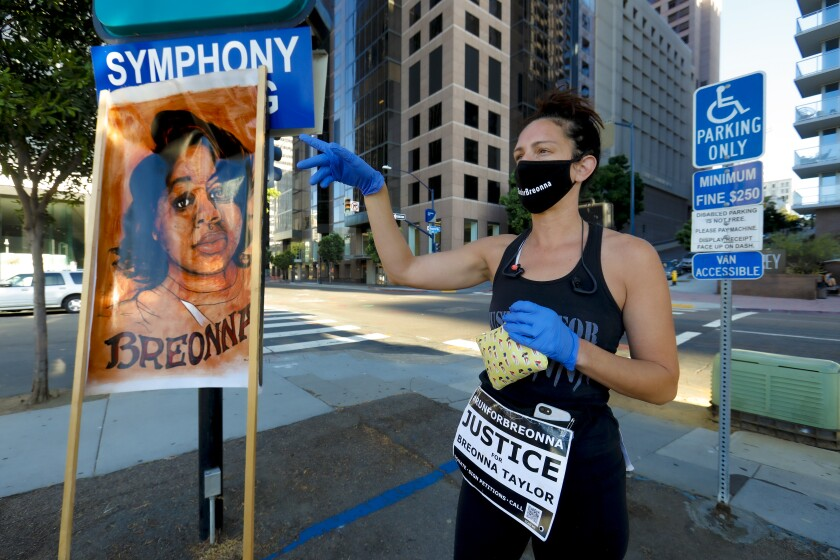 """In downtown San Diego, Gina Wickstead helped organize a 5k run on Saturday to show """"Unity for Breonna Taylor""""."""